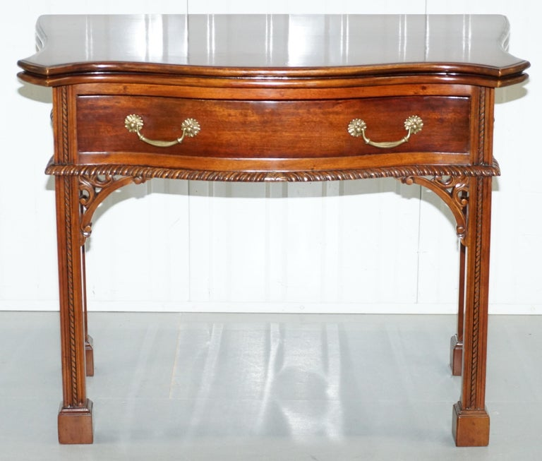 We are delighted to offer for sale this lovely George III style tea card table in the manor of Thomas Chippendale  A very good looking and well-made piece, the table is made from solid English Mahogany, it based on the early George III tea tables
