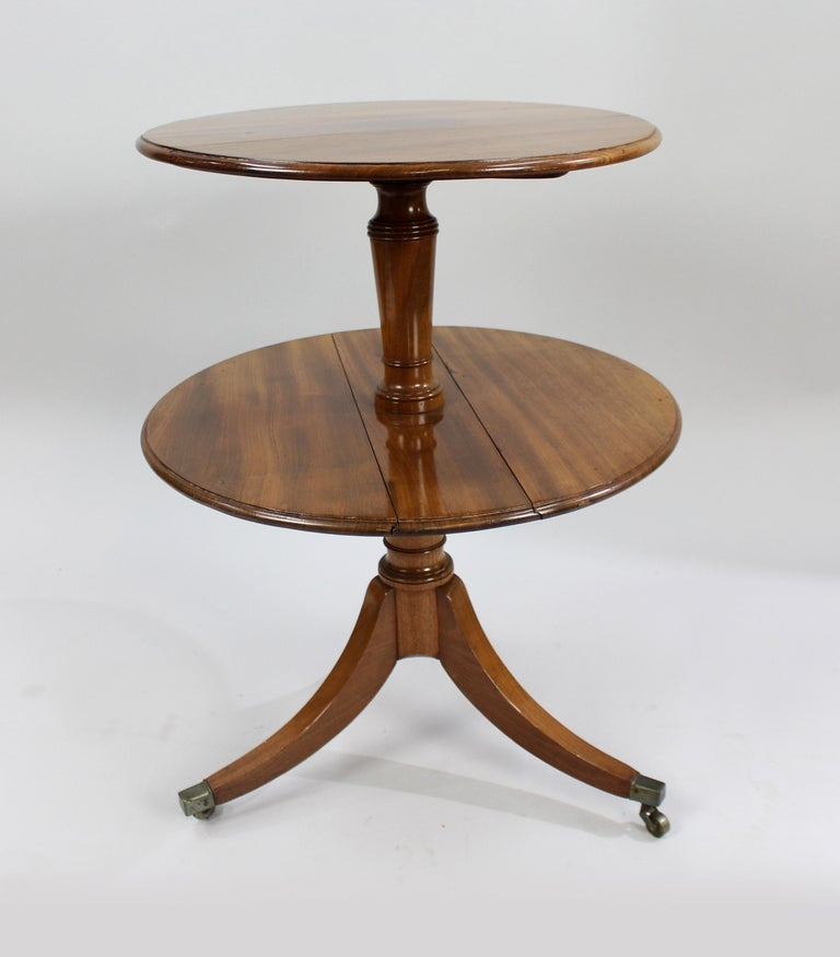 George III English mahogany two tier folding dumb waiter   First tier diameter 52 cm 20 1/2 in  Second tier diameter 60 cm 23 1/2 in  Height 75 cm 29 1/2 in    Period George III, c.1800, English  Wood mahogany  Condition good original