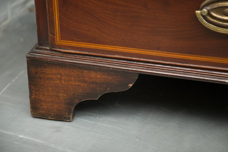 This a handsome 18th century mahogany bureau bookcase with satinwood stringing overall. The top section with shaped cornice over two glazed doors with arched mullions over cylinder roll-top, opens to reveal satinwood drawers and document