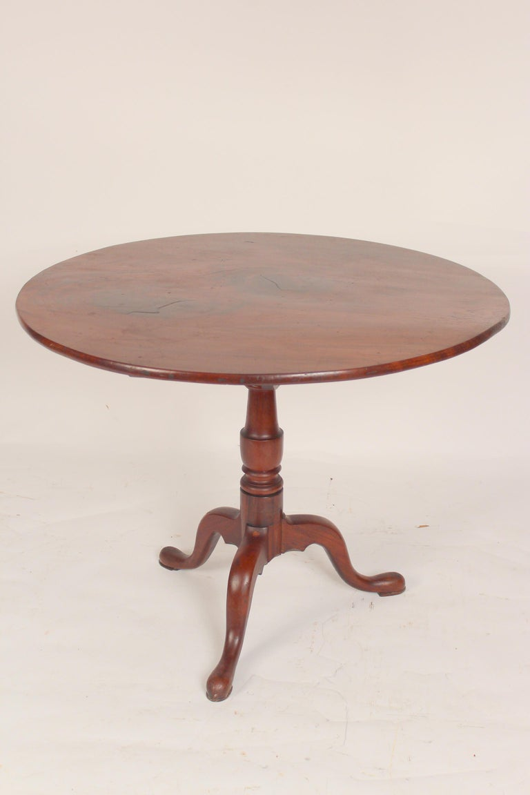 George III mahogany tilt top table, late 18th century. With a nicely figured 37