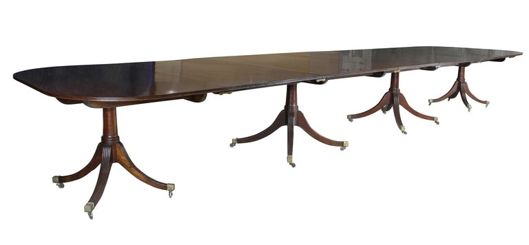 With a reeded edge and rectangular top of very generous proportions, each section with tilting mechanism, the four sections each raised on four turned supports each with four reeded splayed legs with square caps and casters. Additional edge leaves