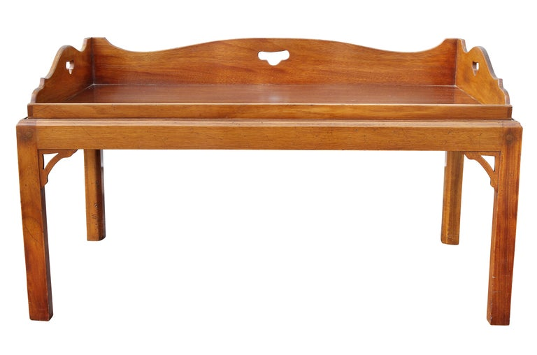 Three quarter gallery with open handles and conforming rectangular tray with a separate base with square section legs and corner spandrels.