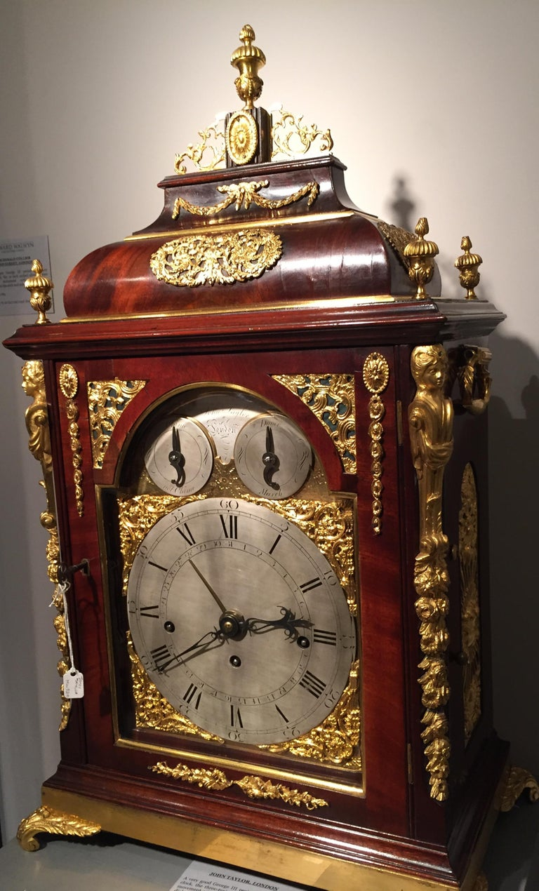 A rare musical bracket clock by this excellent clockmaker. The elegant mahogany case has an inverted bell top and retains its original ormolu mounts, finials and feet. The case is of a rich, deeply patinated mahogany with gilt mounts and cast brass