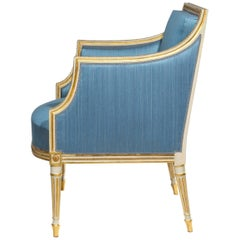 George III Neoclassical Cream Painted and Parcel-Gilt Bergere Armchair