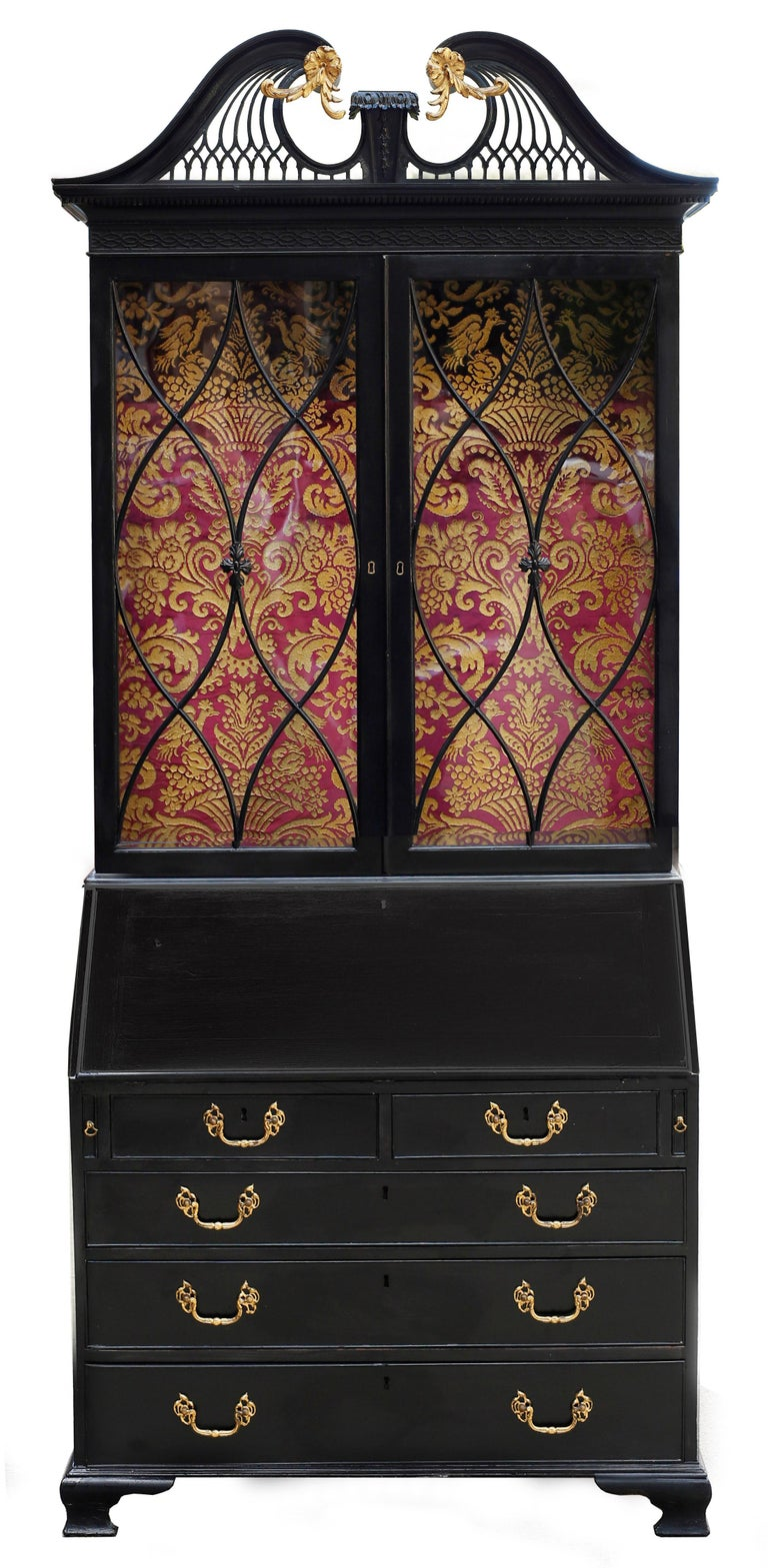 An exquisite English Georgian secretary bookcase of exceptional design and detail. The swan-necked broken pediment features gilt acanthus flourishes and rosettes with a central plinth with graduated bellflowers. The tympanum is composed of delicate