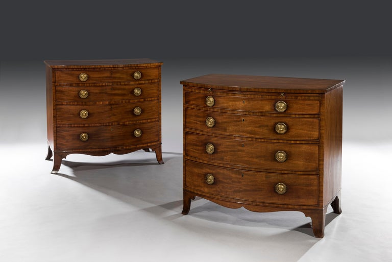 The near pair of mahogany chests retain identical original handles, locks and escutcheons and share the same drawer linings (cedar, mahogany and deal). The drawer fronts on both the chests have the same mahogany veneers and faded ebony stringing to