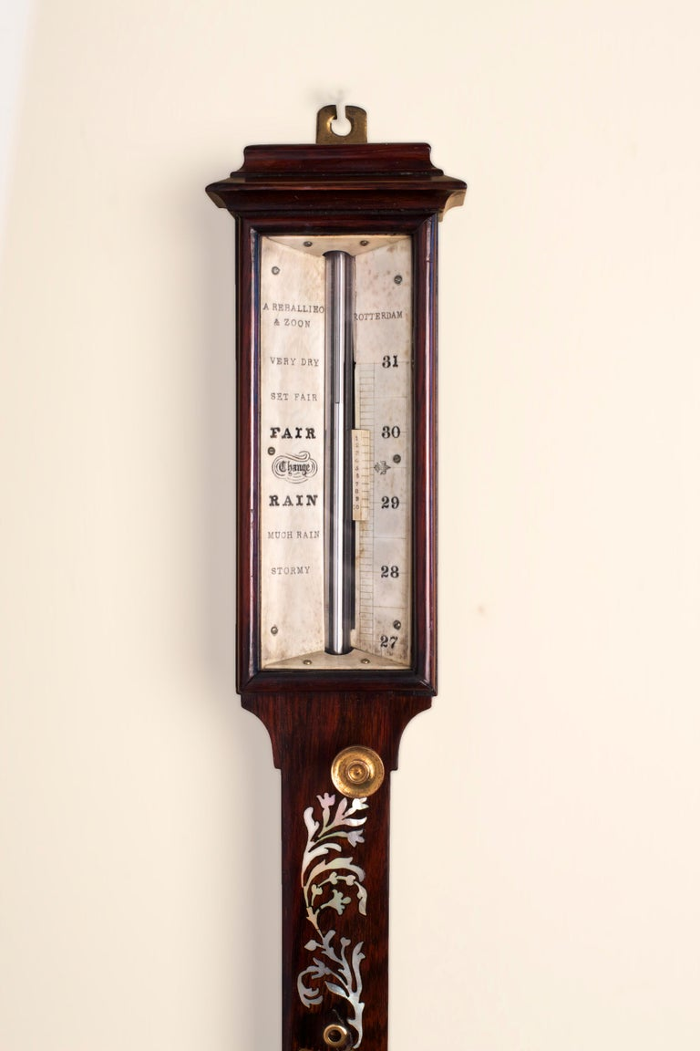 George III caddy top rosewood Marine stick barometer with enclosed portable mercury tube and brass cistern cover.   Central mercury thermometer with Fahrenheit and Reaumur scales.    Ivory register plate with sliding vernier signed 'A.Reballieo