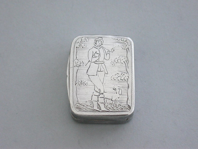 A very rare George III silver Vinaigrette of plain rounded rectangular form, the base and sides with prick-dot engraved decoration, the lid engraved with a scene depicting a Woodcutter or Gamekeeper smoking a pipe with a dog at his heals. The silver