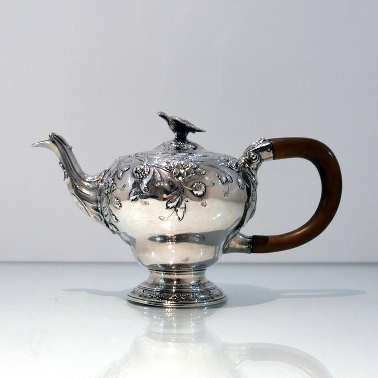 A rare and extremely fine early George III Rococo bachelor teapot decorated with fabulous contemporary floral embossing. The slightly domed lid has an elegant flush hinge and is crowned with a stylish finial.   Weight: 18.25 troy ounces/567
