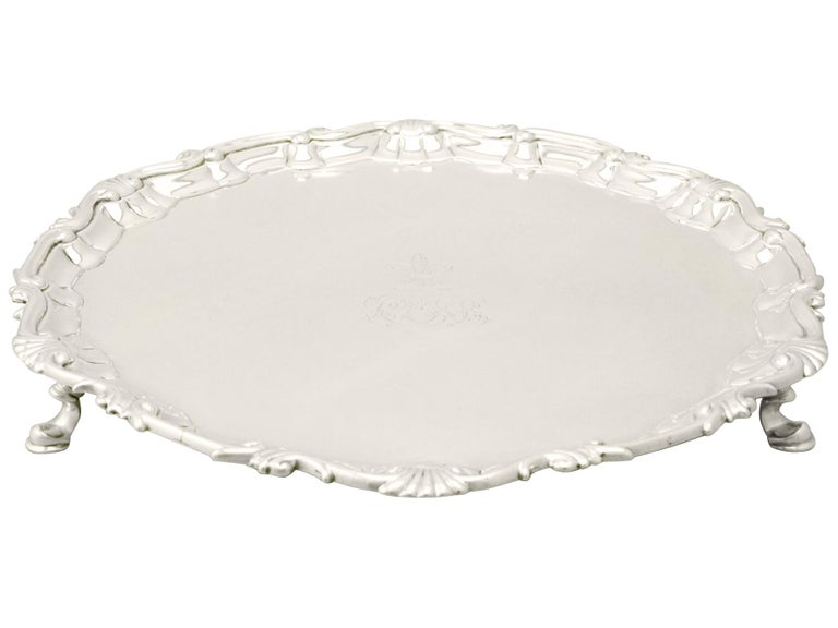 A fine and impressive antique Georgian English sterling silver salver; an addition to our dining silverware collection.  This fine antique George III sterling silver salver has a plain circular shaped form, in the classic English form.  The