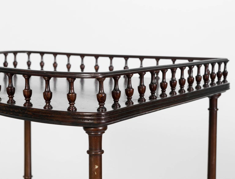 George III style mahogany three-tiered corner stand. Has a gallery rail on the top shelf . Would make a perfect bar accessory piece for great for a corner piece in the bath.