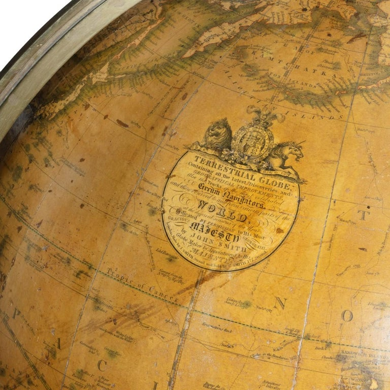 A George IV 18 inch George Smith terrestrial globe, set in a mahogany tripod Stand with a turned baluster support and slender square-section legs with the original castors. Compass dish and rose replaced. Signed within an elaborate roundel