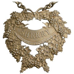 George IV Cast Silver Gilt Festooned Drapery Wine Label 'Sherry', 1829