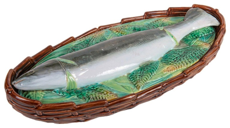 George Jones Majolica tureen with cover which features a mackerel fish lying on a bed of fern leaves and reeds. Coloration: yellow, green, grey, are predominant. The piece bears maker's marks for the George Jones pottery. Bears a pattern number,
