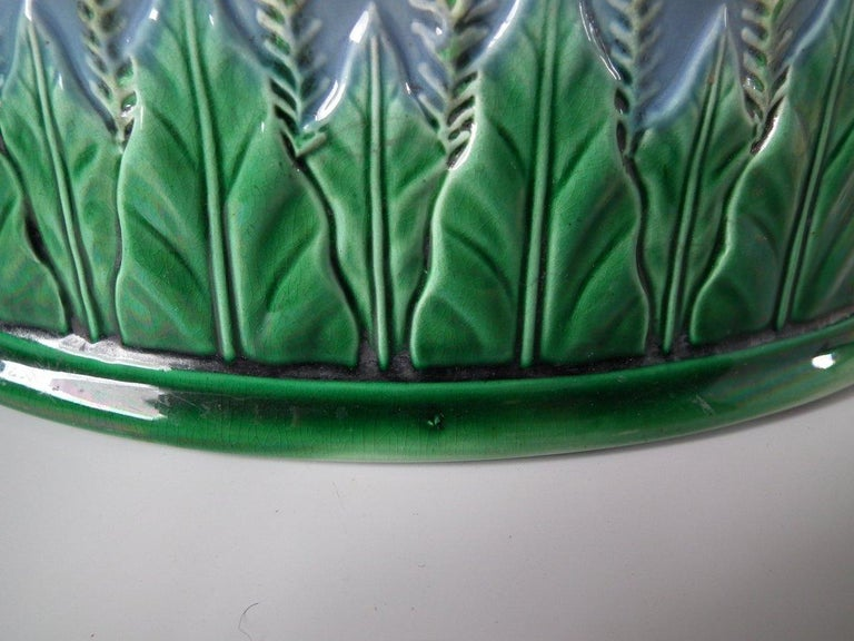 George Jones Majolica game pie dish which features a partridge on the cover with barley and stiff leaf decoration to the dish. Rare, Indigo ground version. Coloration: Indigo, green, brown, are predominant. Book reference, 'George Jones Ceramics