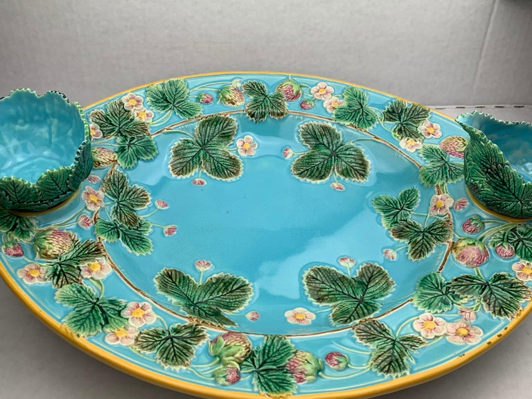 George Jones Majolica strawberry server with separate cream and sugar, English, 1879. Naturalistically molded strawberries, strawberry leaves and blossoms to the inner and outer border, the center bowl and ground glazed in deep turquoise blue, with