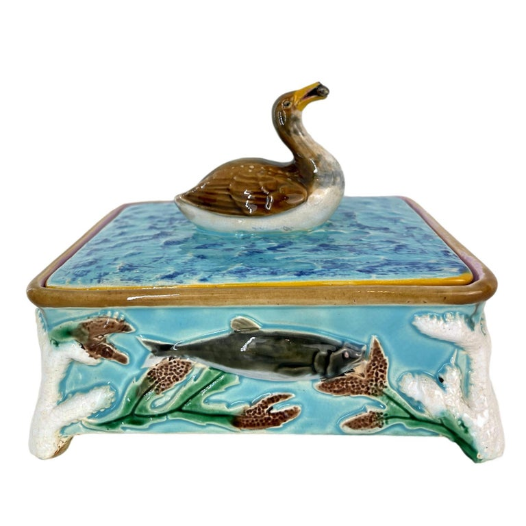 George Jones Majolica Turquoise Sardine Box, Duck (actually a Grebe) and Fish, English, ca. 1874, the box molded in high relief with a salmon on each of the four sides, each corner with molded coral forming the raised feet, the lid with simulated