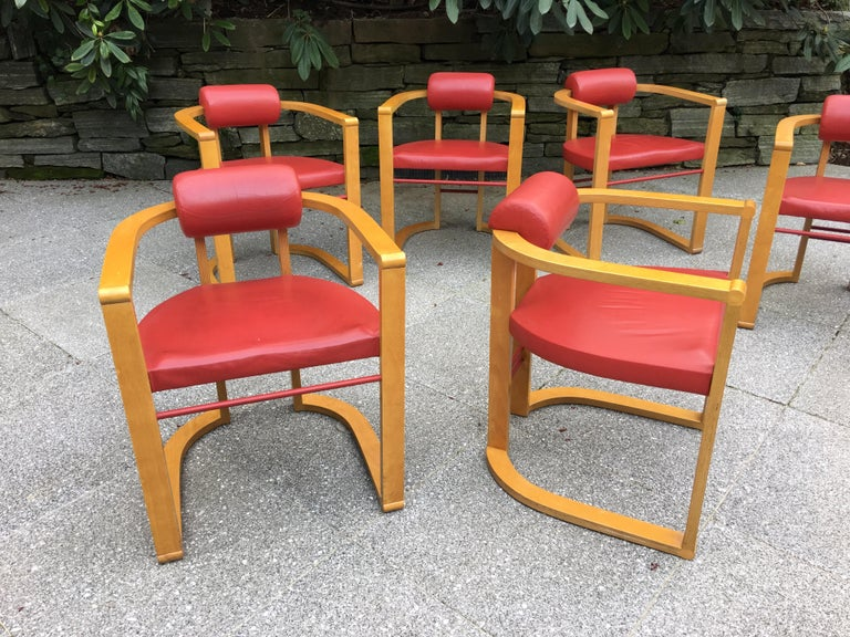 Set of 6 George Kasparian dining chairs in a blond finish with red leather Upholstery. Wood is made up of laminated layers of birch or maple. From the original owners, purchased in 1988. Shown in last photo with a custom designed burled maple