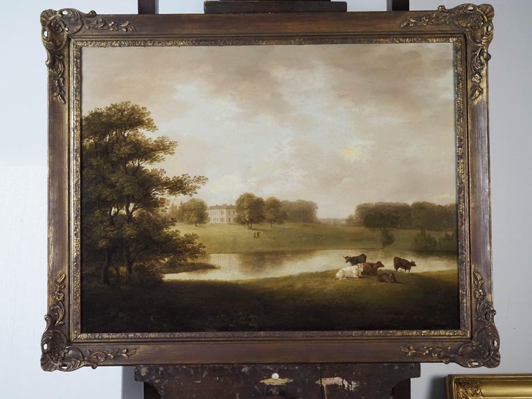 Circle of George Lambert A view of an English Country house in idyllic parkland with cattle grazing Oil on canvas Canvas size 25 3/8 x 33 1/2 in (64.5 x 85 cm) Framed size 31 1/2 x 39 1/2 in  George Lambert is of unknown parentage. His birth date is