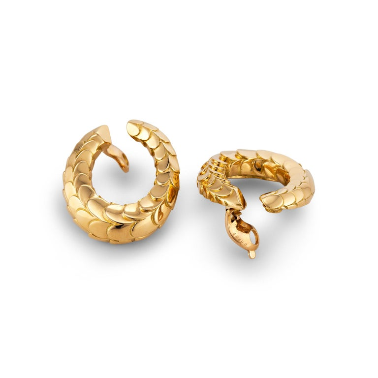 The perfect gold clip hoop earrings have finally been found!  With a chic scale surface pattern, these bespoke earrings were designed in the 1970' by George L'Enfant for Cartier Paris and will easily take you from day to night.  18 karat yellow