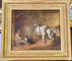 19th century Victorian English Boy seated in a barn feeding his dog and donkey