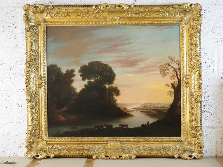 A herdsman with cattle in a classical river landscape For Sale 1