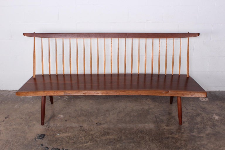 A walnut bench by George Nakashima signed and dated 1976. Sold with full documentation.