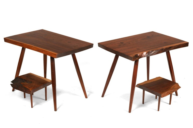 An unusually versatile pair of Nakashima tables. The second tier is free to be repositioned on the tabletop.