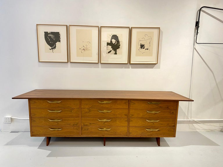 Chest of 12 drawers by George Nakashima, model OH - 212 L with bookmatched walnut drawer fronts and brass handles, designed for Widdicomb, circa 1950. Cabinet retains its fabric label and is branded with manufacturer's mark to drawer George