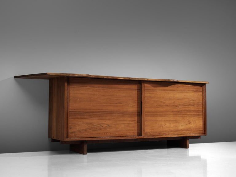 George Nakashima, sideboard, American walnut, United States, 1958  This cabinet by George Nakashima features sliding drawers, and a large slab spanning past the edges of the cabinet. Nakashima designed the piece to express the character of this