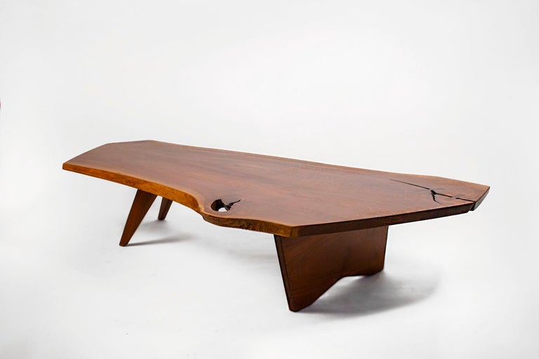 Custom ordered in 1963, this early George Nakashima Studio coffee table is one of the larger examples of this form measuring in at over six feet long. The freeform edges are amazing. The stunning sap grain, the slight inclusion with the solid