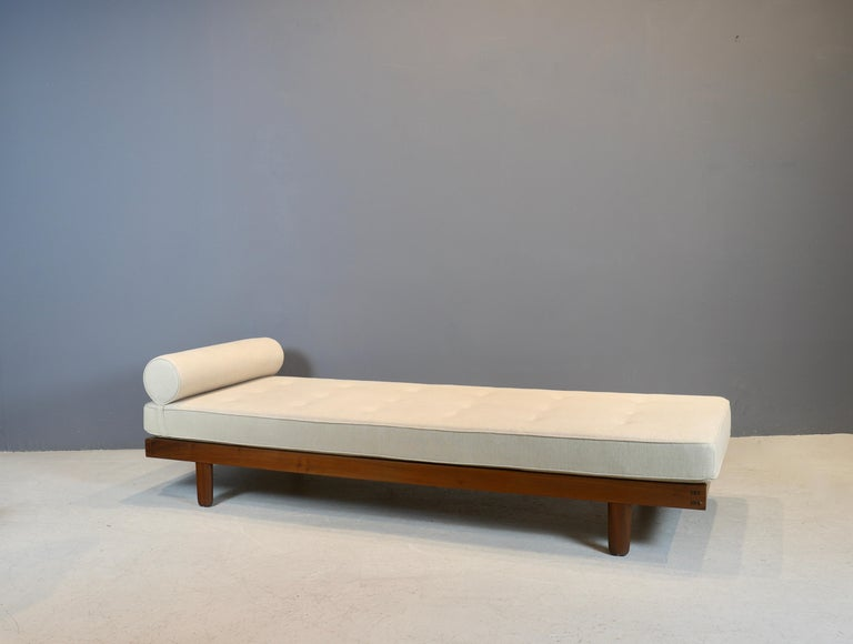 Custom size, extra long daybed by New Hope studio artist George Nakashima, circa 1950s. Frame is in Black American walnut, retaining its original webbing, with newly made cushion in oatmeal linen. This daybed is currently in my showroom in