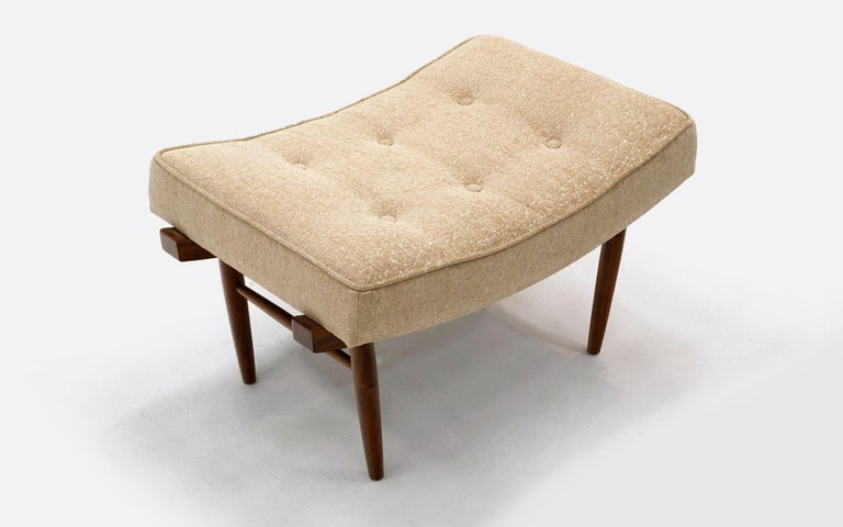 Low stool, ottoman, or vanity stool designed by George Nakashima for Widdicomb. Walnut base with original upholstery. No stains or tears. Shocking good original condition.