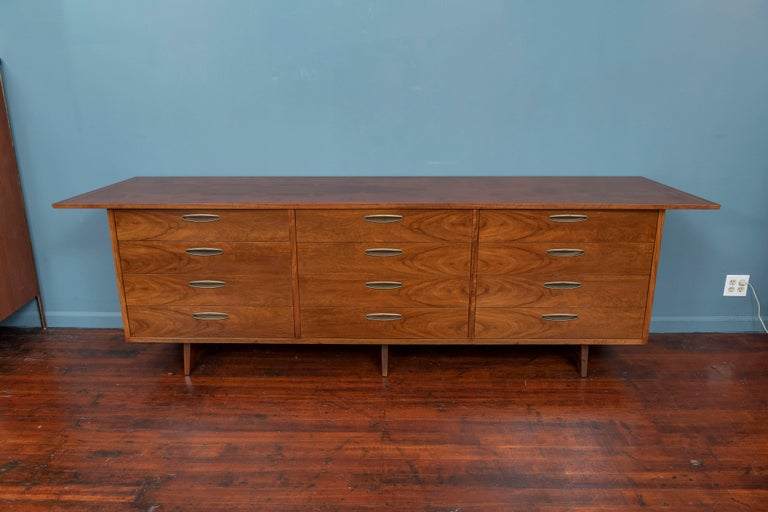 George Nakashima design dresser for his Origins line by Widdicomb, 1959. Dramatic wood grain figuring throughout the body of the case and trapezoidal shape top extending to 105