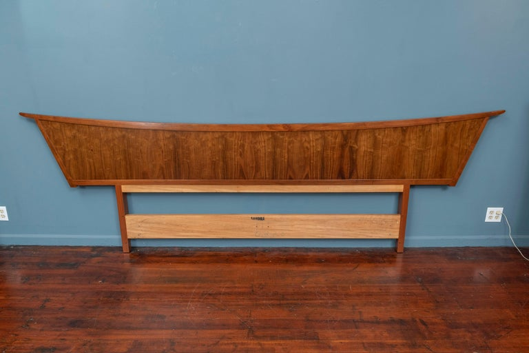 George Nakashima design headboard for a king or queen sized bed for his Origins series by Widdicomb, 1959. Constructed of East Indian Laurel wood in the original Sundra finish, cleaned and waxed and ready to install. The complete bedroom set is