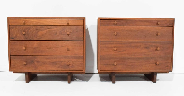 Pair of chests, 1961, in American black walnut by George Nakashima. Accompanied by original digital receipt. Client name signed on back of each chest.