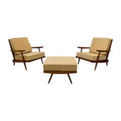 George Nakashima, Pair of Cushion Armchairs and Ottoman, 1955