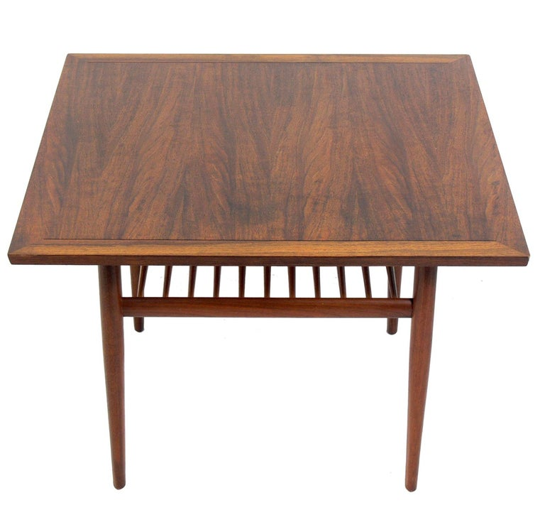 Clean lined walnut table, designed by George Nakashima for Widdicomb, American, circa 1960s. This piece is a versatile size and can be used as a side or end table, or as a nightstand or drinks table between two chairs.