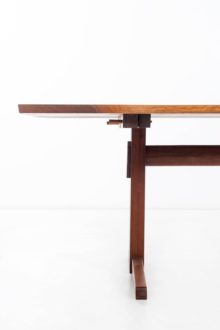 Custom Nakashima Studio Important Trestle Table, American black walnut, two solid book-matched slabs with sap grain details, numerous free edges, expressive figuring and five rosewood butterflies. 