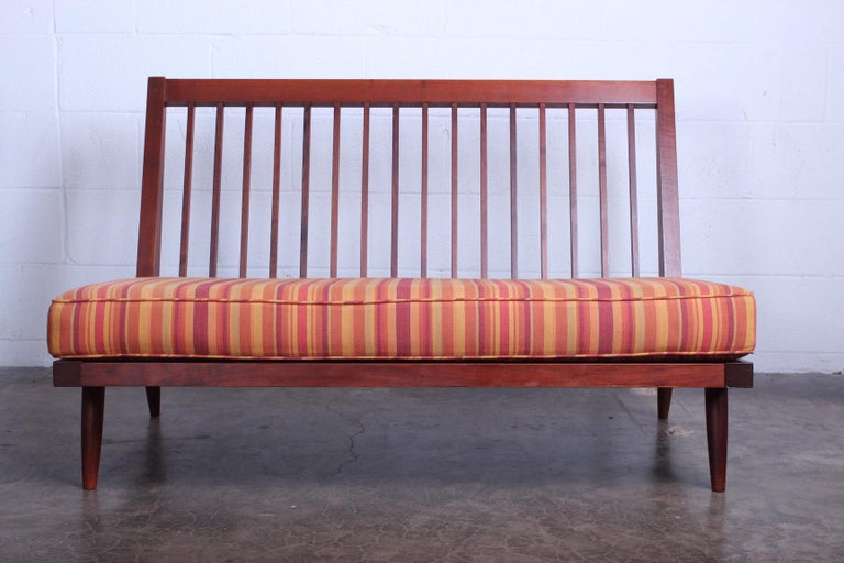 A walnut settee by George Nakashima, 1961. Sold with a copy of the original receipt.