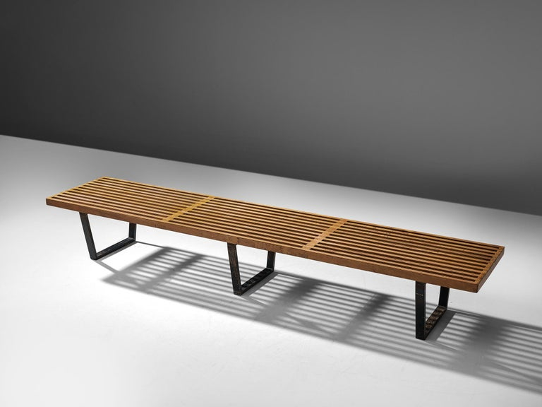 George Nelson & Associates for Herman Miller, slat bench model 4492, birch and lacquered wood, United States, 1946.  The Slat Bench was part of the first collection that George Nelson designed for Herman Miller.The top was formed by an open grid
