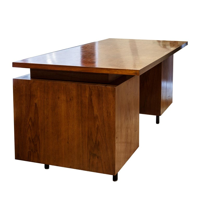George Nelson designer writing desk in rose wood legs in Stel from Hermann Miller Production 1960s United States.