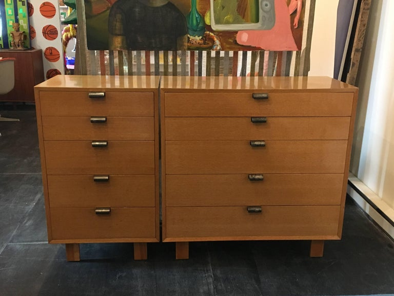 Pair of George Nelson five-drawer dressers for Herman Miller, circa 1948.  Combed oak, drawers with dividers and
