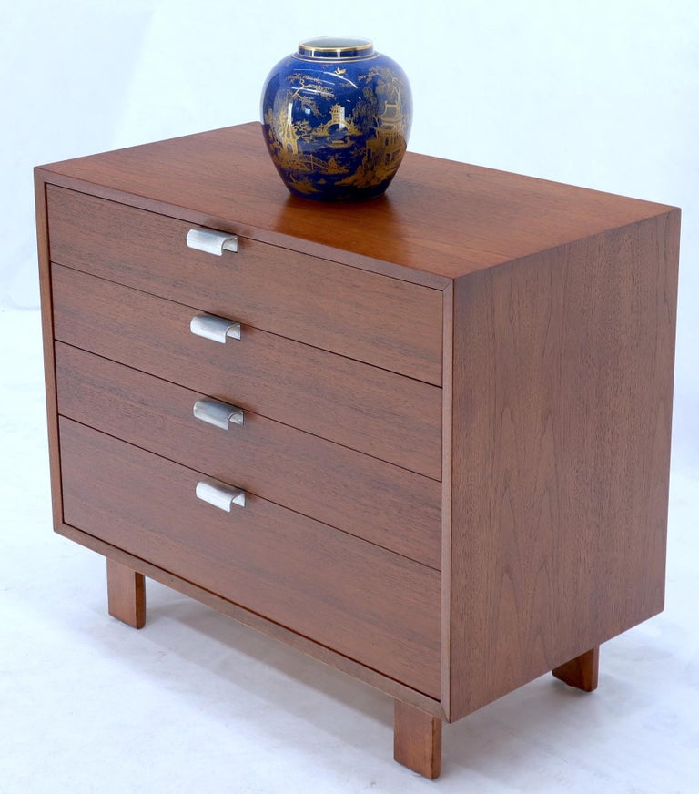 Mid-Century Modern walnut four drawers bachelor chest dresser cabinet designed by George Nelson for Herman Miller.