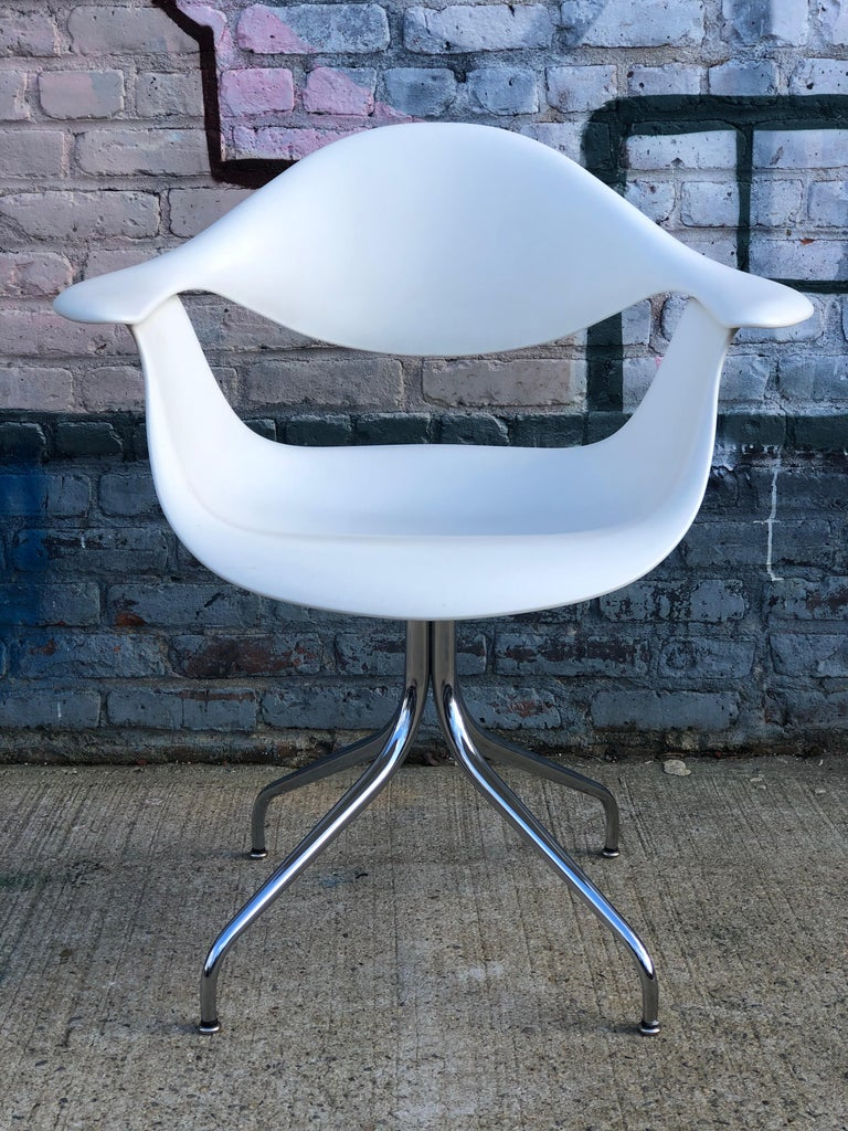 Gorgeous George Nelson model DAF armchair and swag leg desk produced by Herman Miller. In excellent condition. Signed Herman Miller and guaranteed authentic. Beautiful blend of materials and colorful accents.