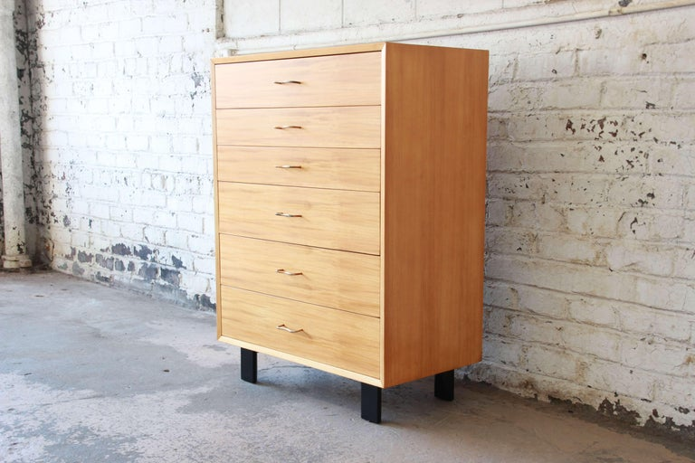 Offering a very nice newly restored George Nelson highboy dresser for Herman Miller. The dresser has six smooth sliding drawer offering varying sizes. The base of the chest has nice signature black legs often seen in Nelson's work. The original