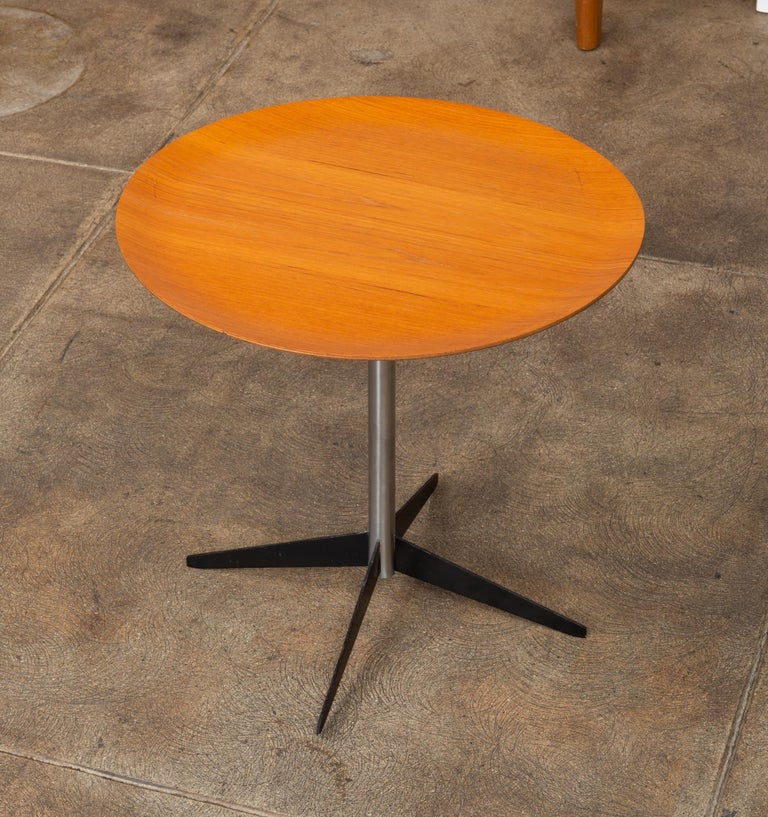 Rare George Nelson for Herman Miller drinks table. This Minimalist side table features a round walnut plywood top, nickel plated steel tube base, with four enameled steel fin legs.  Condition: Excellent vintage condition; professionally cleaned
