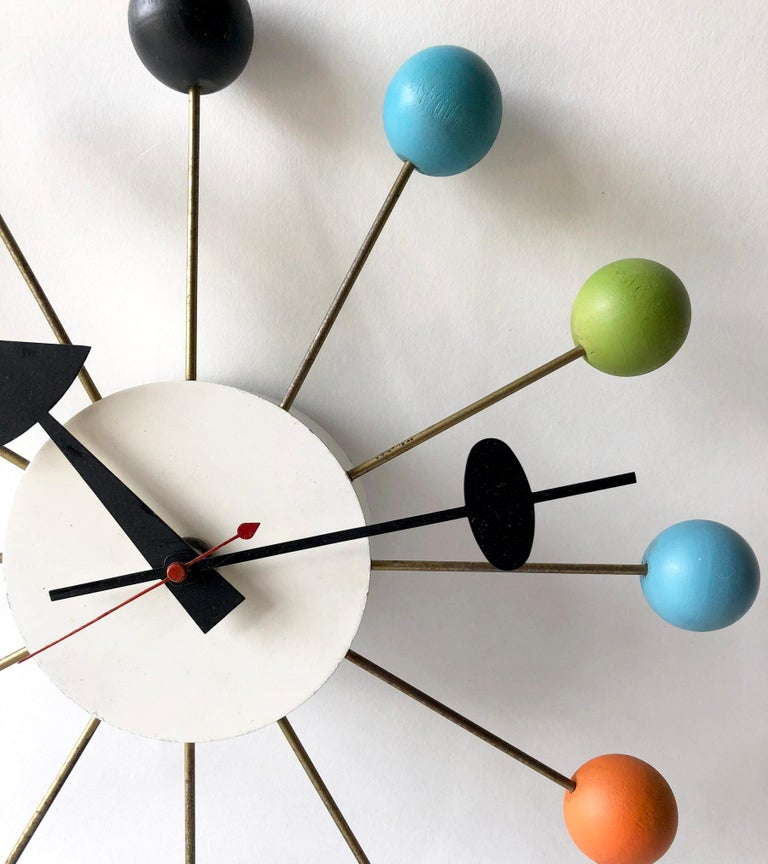 Iconic, vintage modern multicolor atomic ball clock designed by George Nelson for the Howard Miller Clock Company, 1949. This clock is a wall plug in variety and is in great working condition, telling time perfectly. In very good vintage condition,