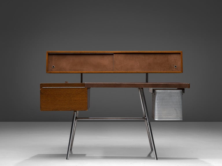 George Nelson for Herman Miller, desk n. 4658, walnut, steel and leather, United States, 1946.  From George Nelson's ground breaking 1948 group of designs for Herman Miller, this desk is a great example of post war modernism. Made of walnut with