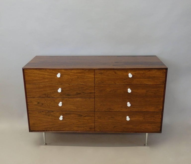 Beautifully grained George Nelson thin edge double dresser. Designed for Herman Miller late 1950s. Rosewood cabinet on aluminum legs. Appears to be original finish in very good to excellent condition.